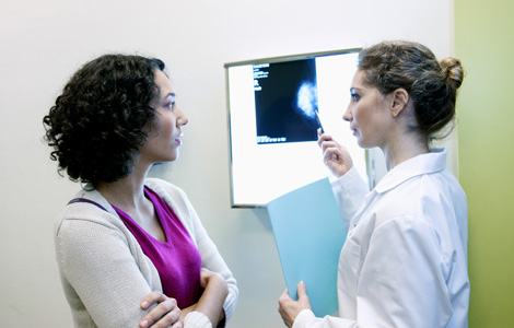 woman and dr looking xrays