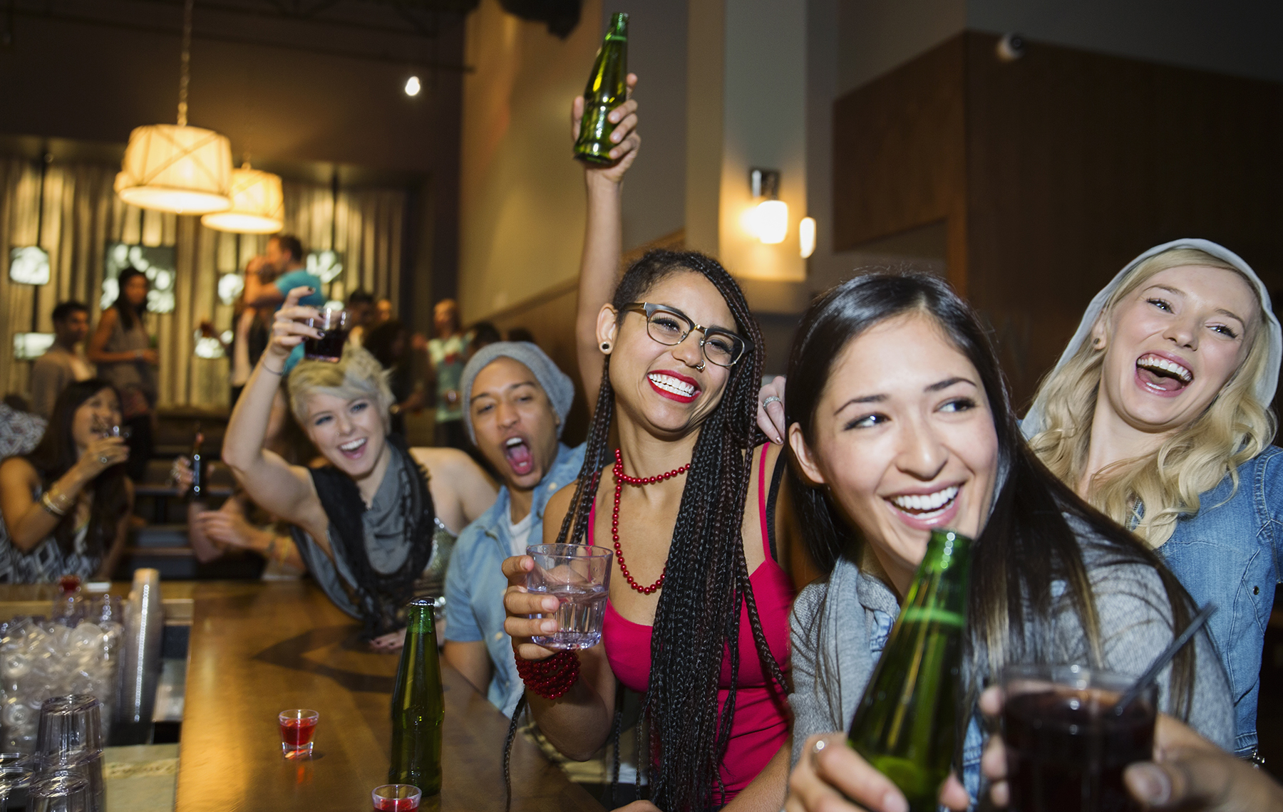 Young people drinking and having fun in a bar