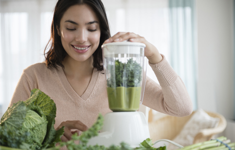 woman making a green drink