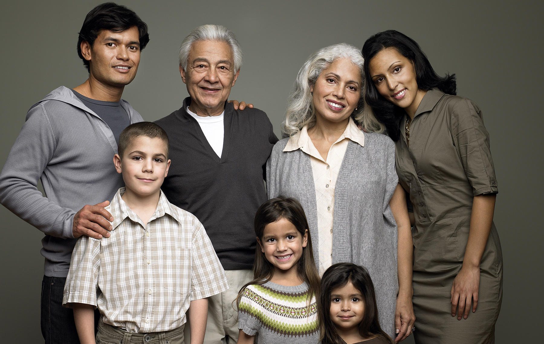 AltaMed Latino family in group shot smiling