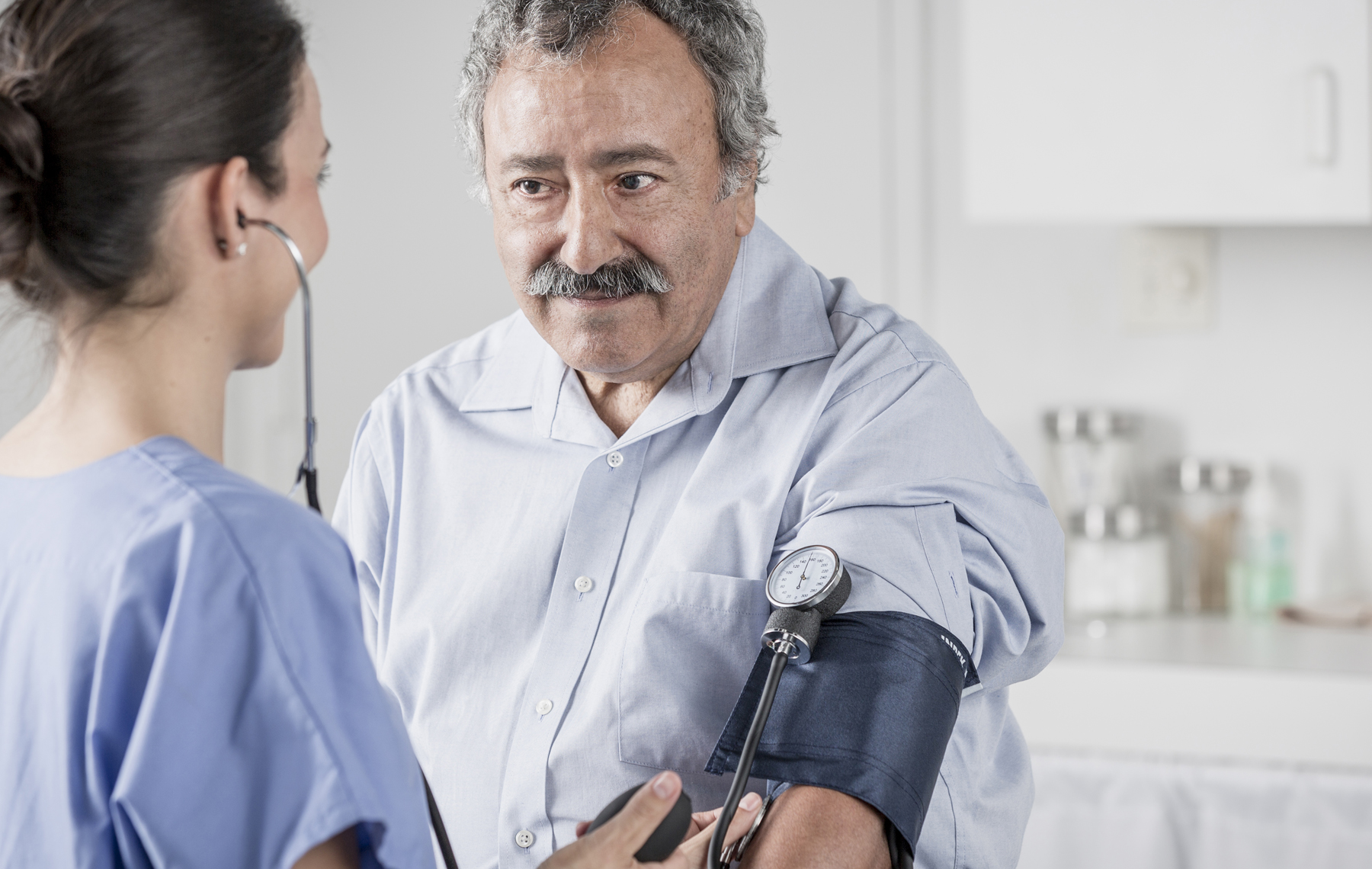 AltaMed man getting blood pressure checked