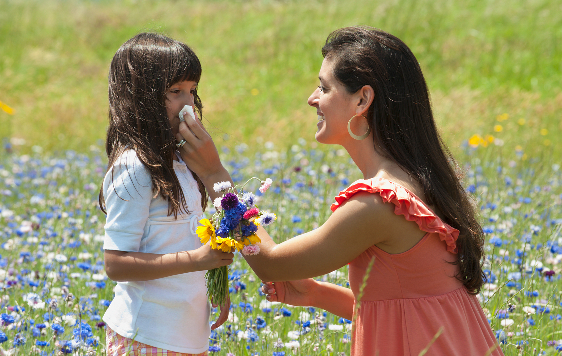 Mom cleaning the nose of her child at a flower camp