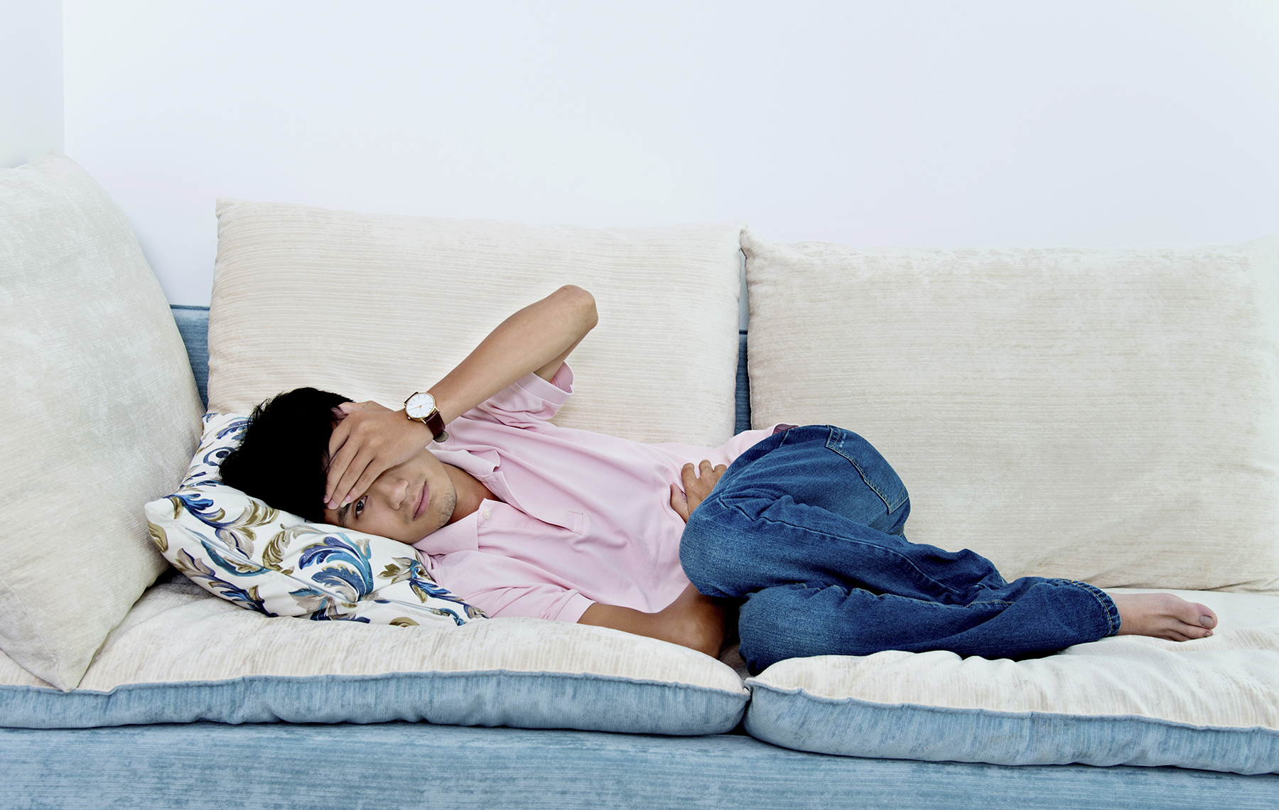 Ill man resting in a couch