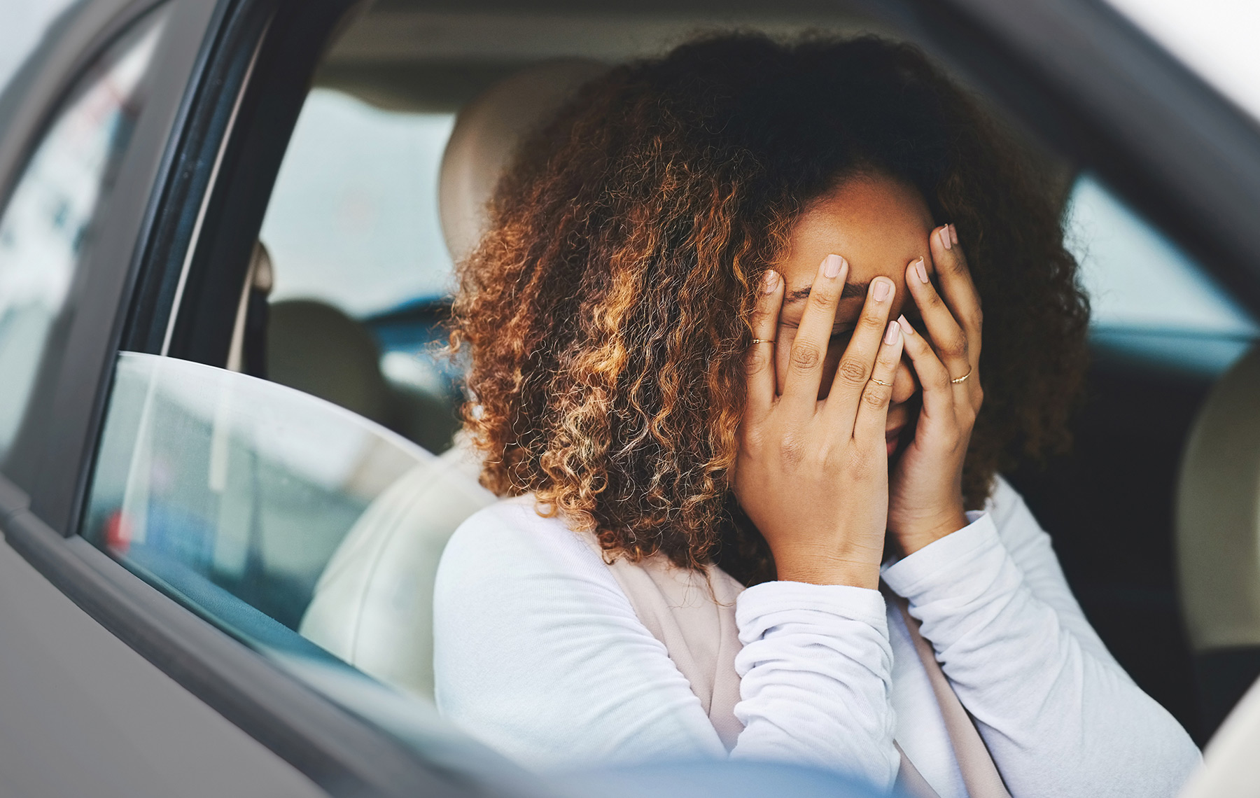 Stressed woman sit inside her car