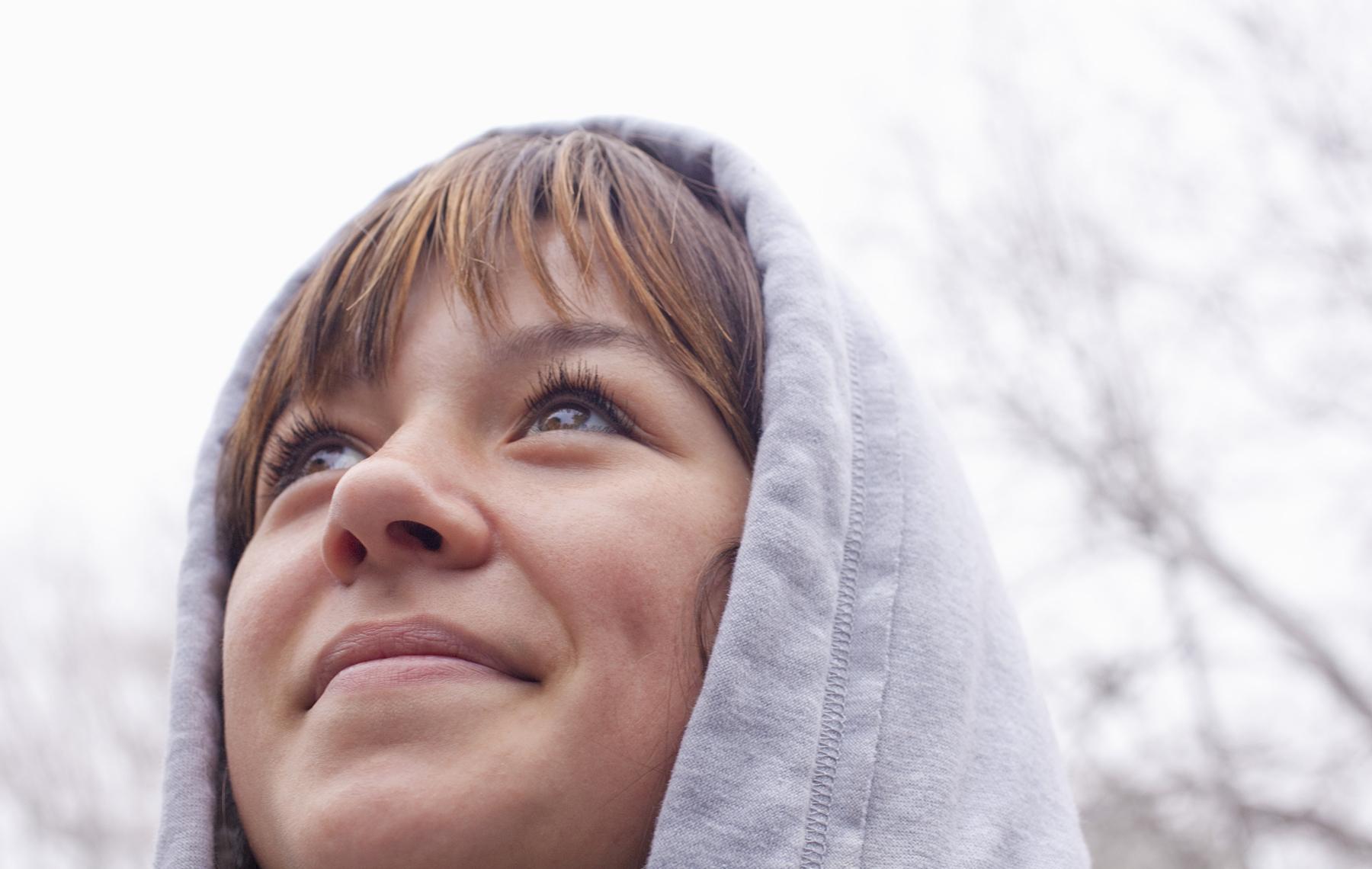 AltaMed woman outside in hoody