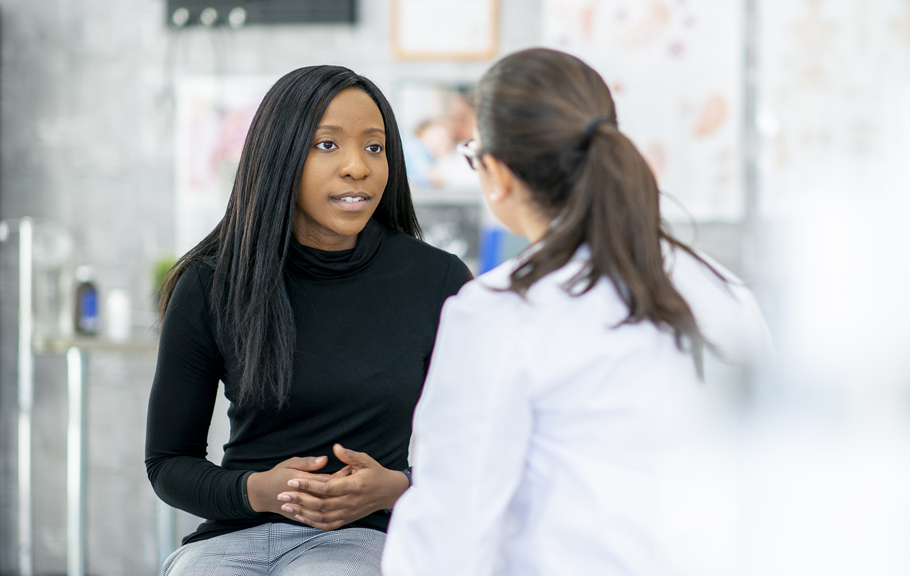 African American woman talking to her doctor