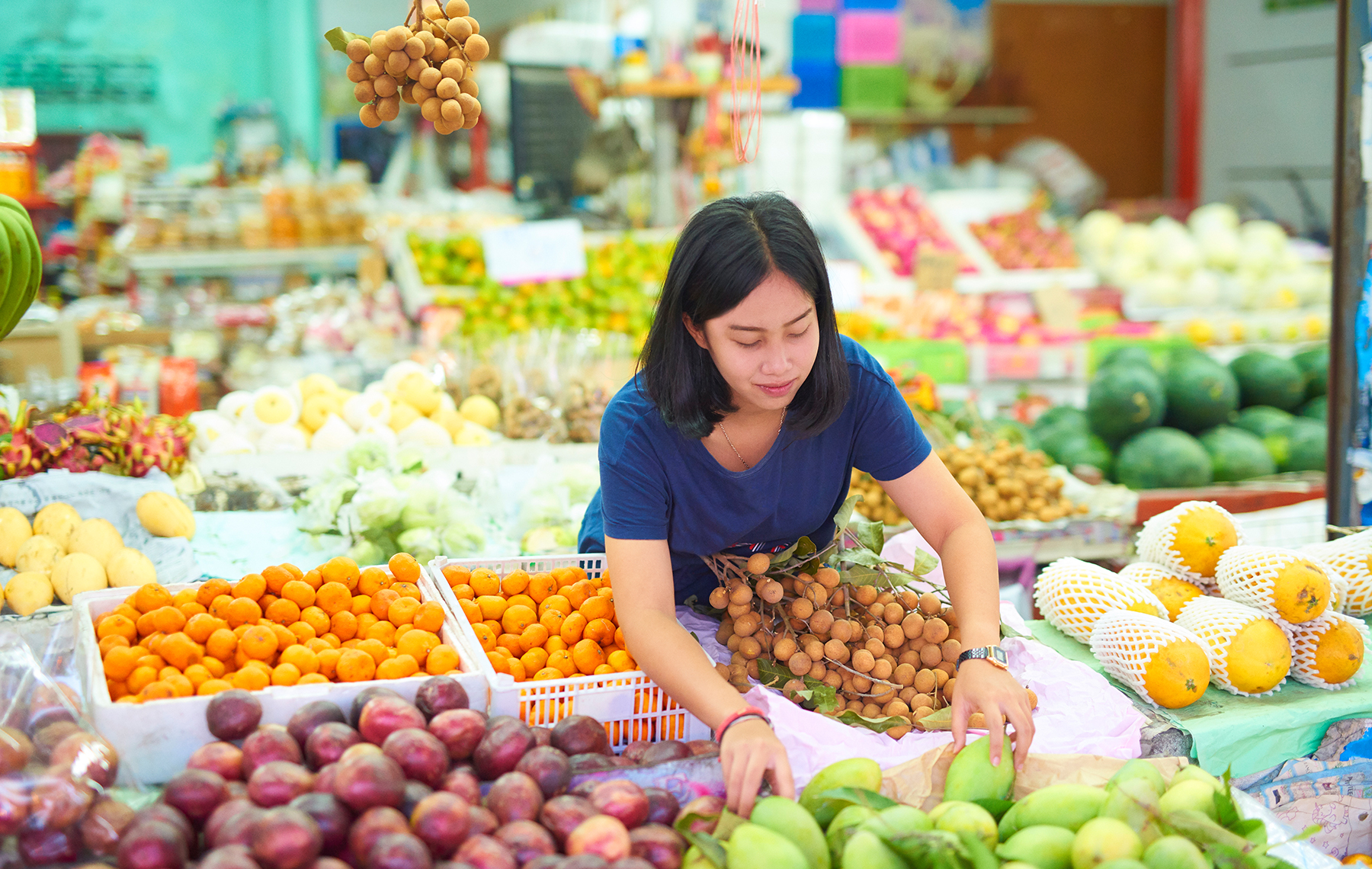 AltaMed woman shopping for fruit