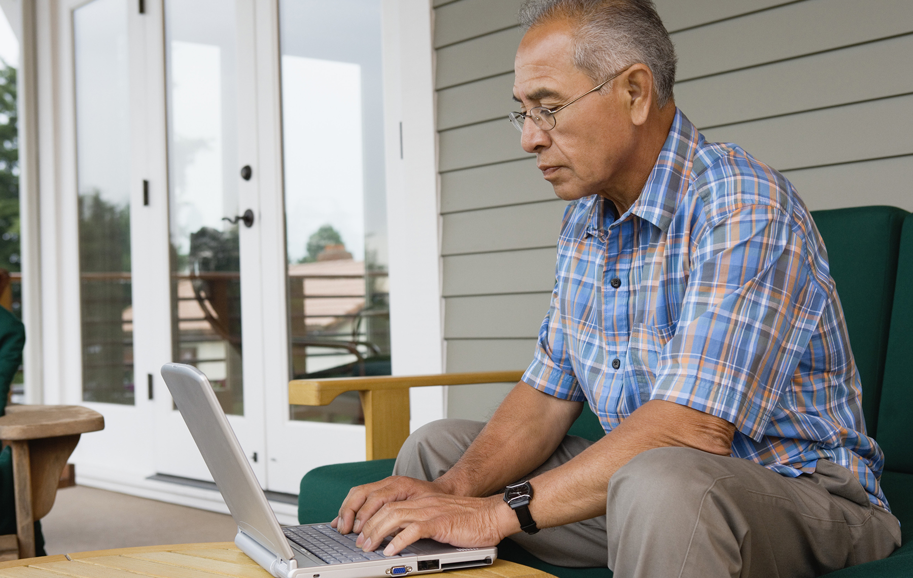 Old man using a computer