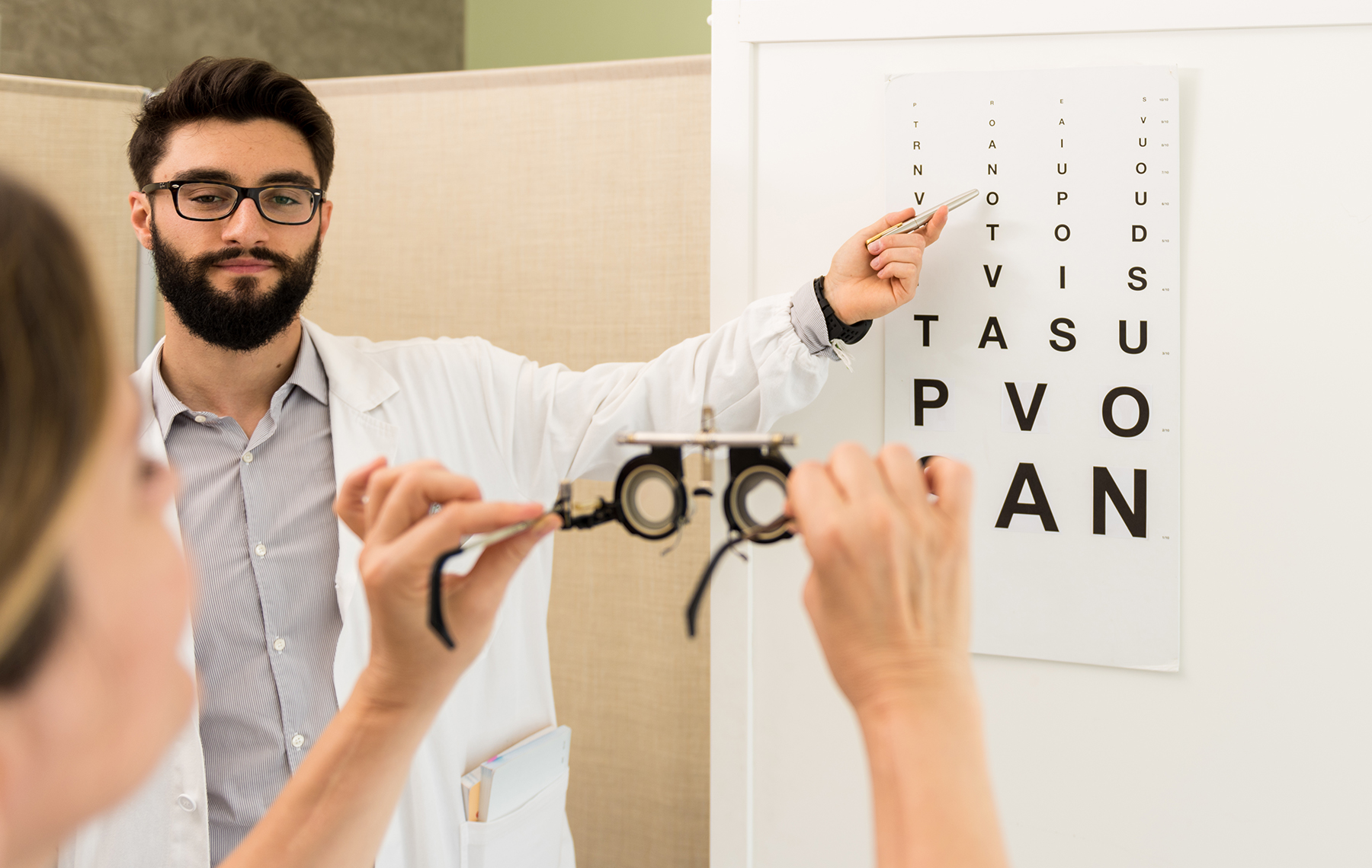 Optometrist pointing at  an optometric table