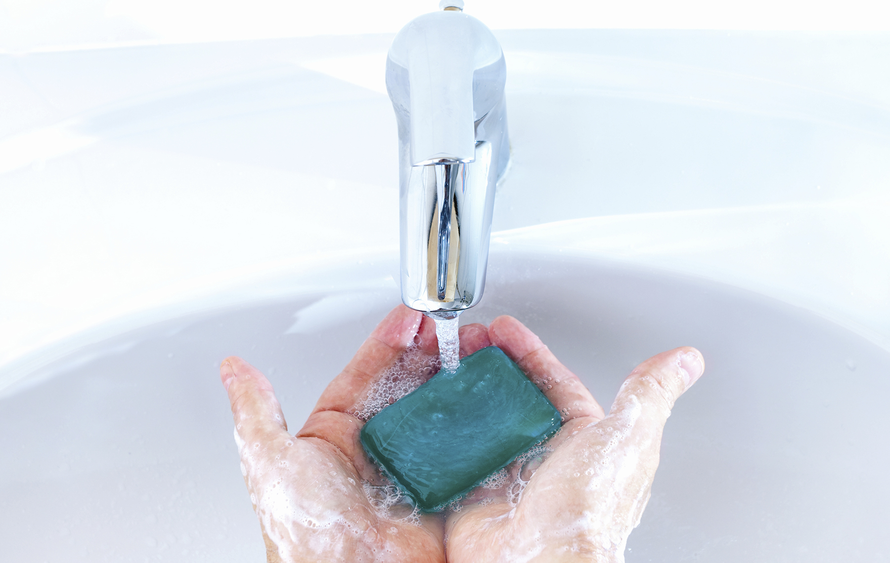 Hands holding a soap