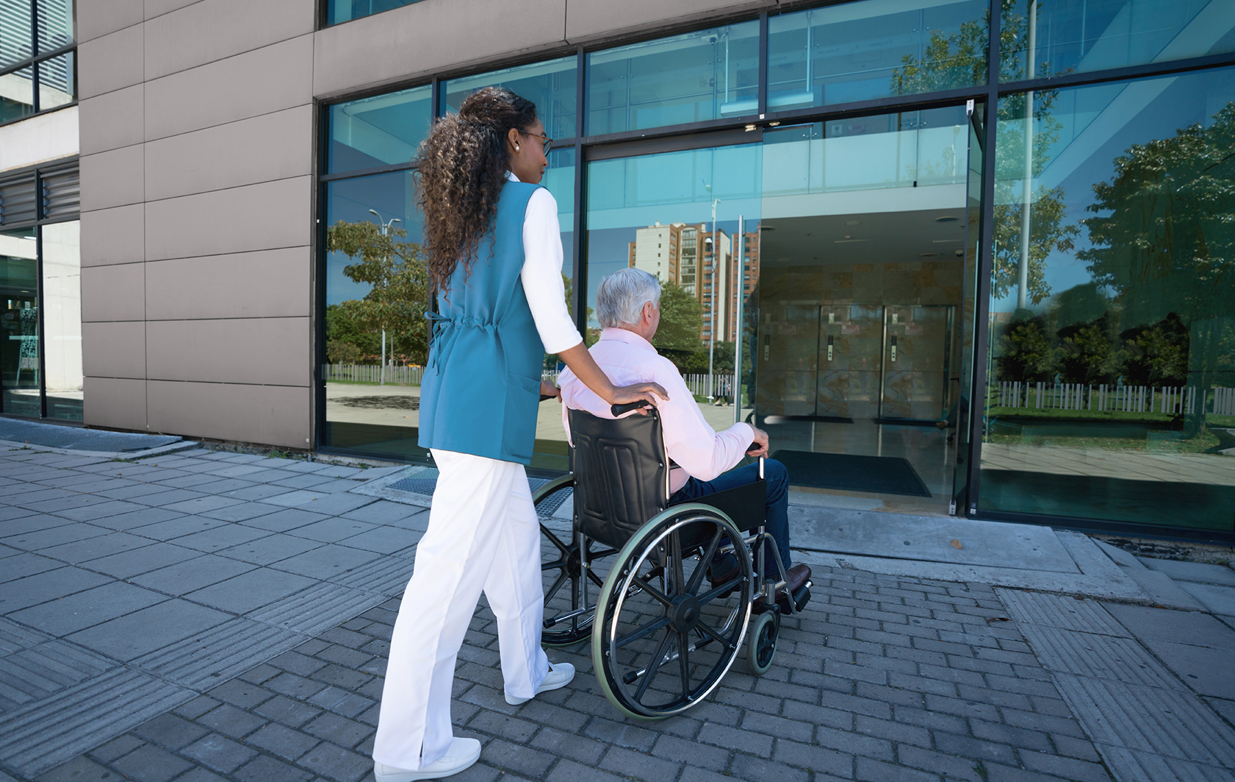 Nurse Pushing a Senior in a Wheel Chair