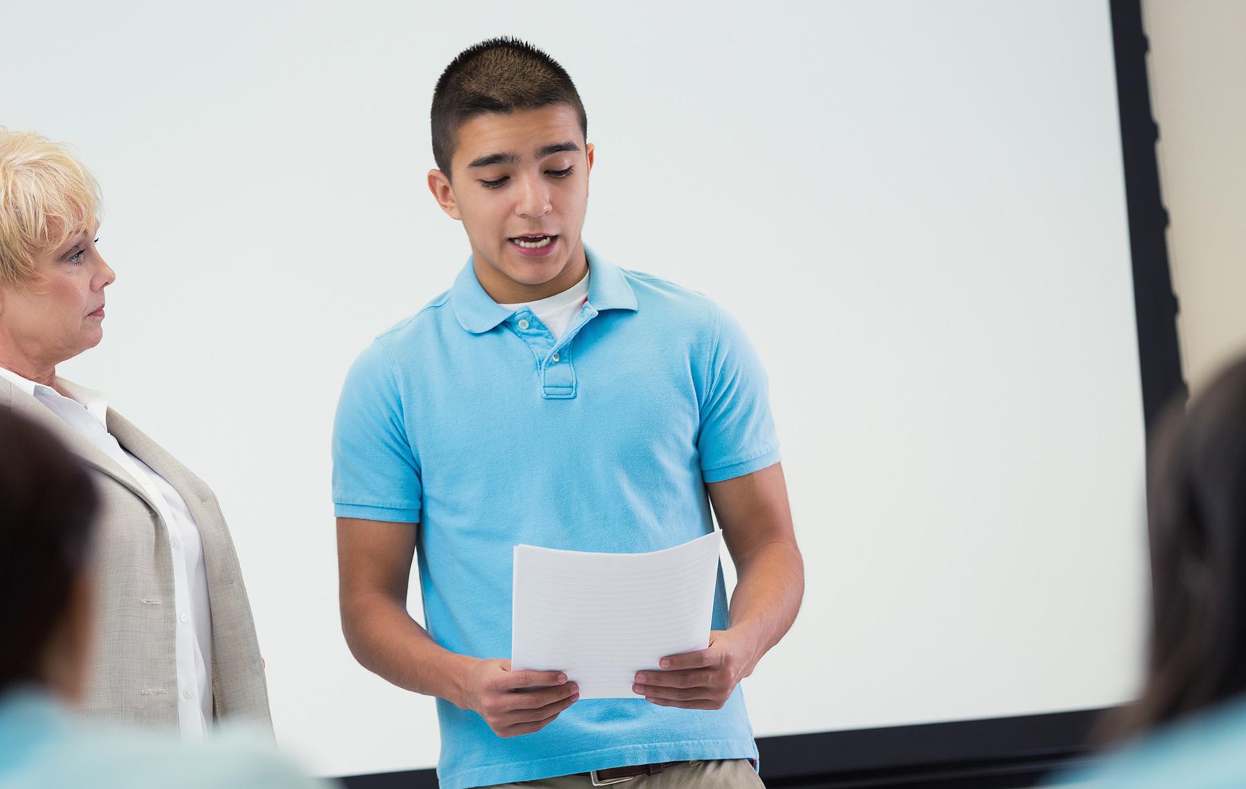 Boy Speaking in Class