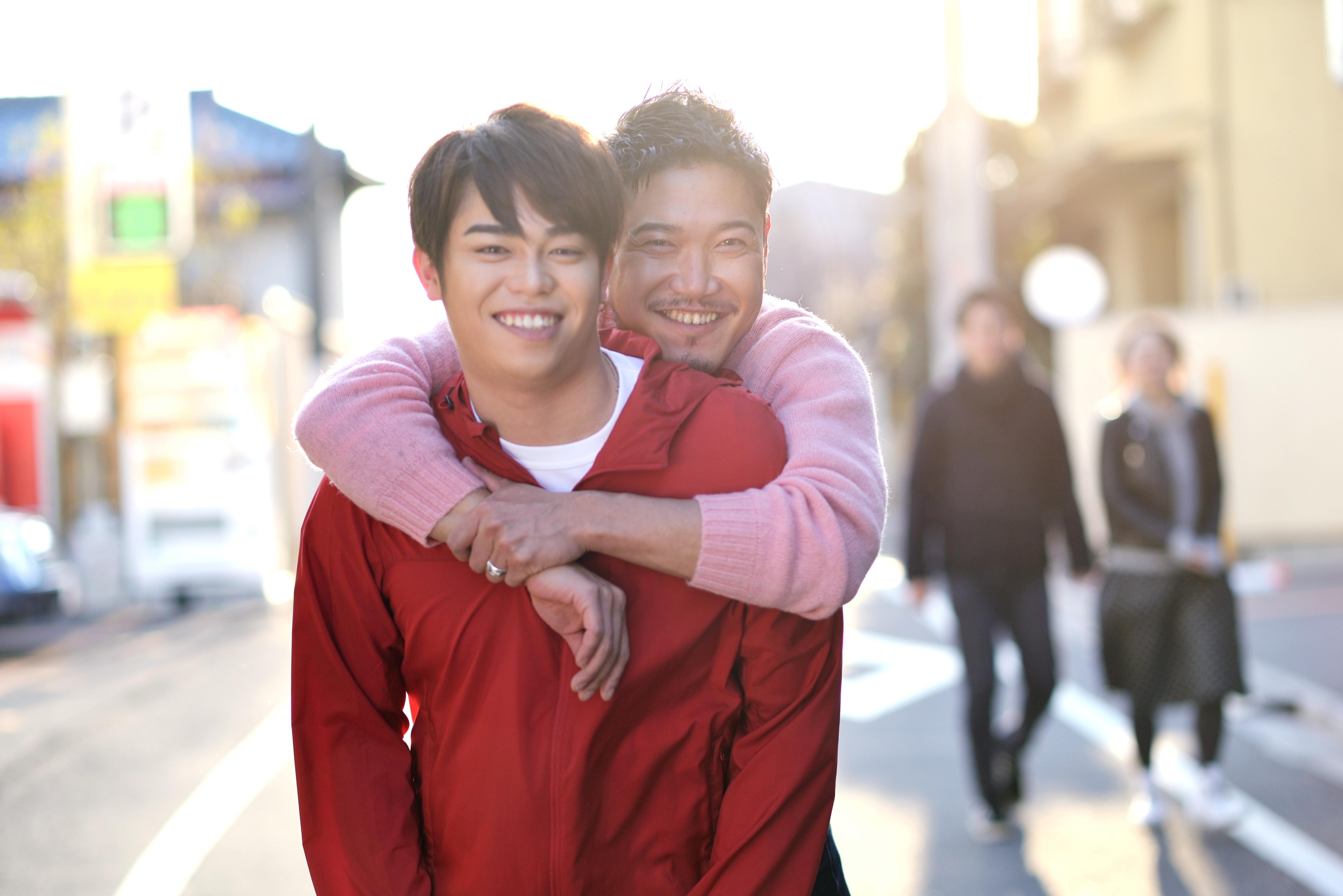 Guys hugging image