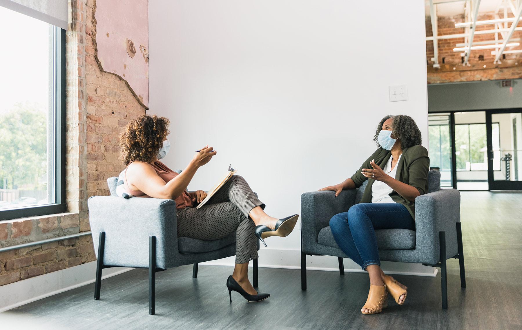 two women talking minority health
