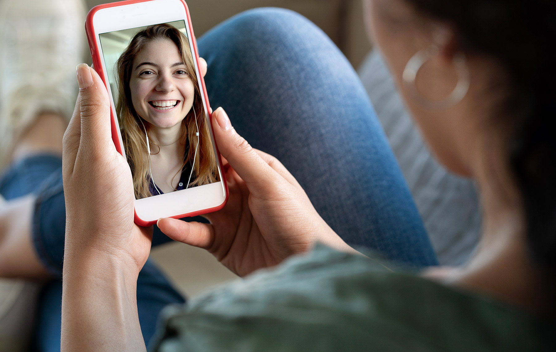 young woman using smartphone for video call-fomo